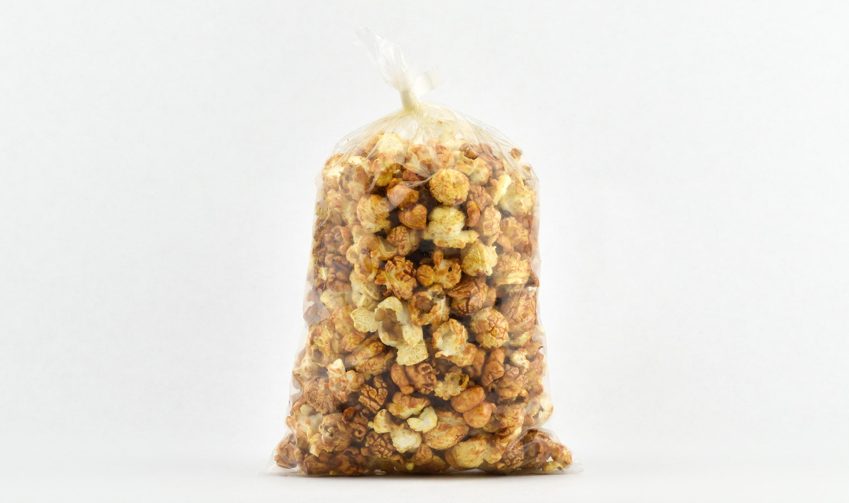 pre-packaged .75 ounce twist sealed caramel corn bag