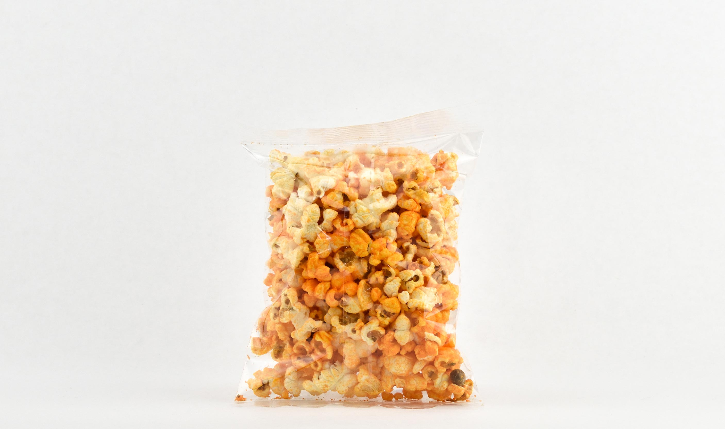 Pre-packaged .75 ounce heat sealed caramel corn bag