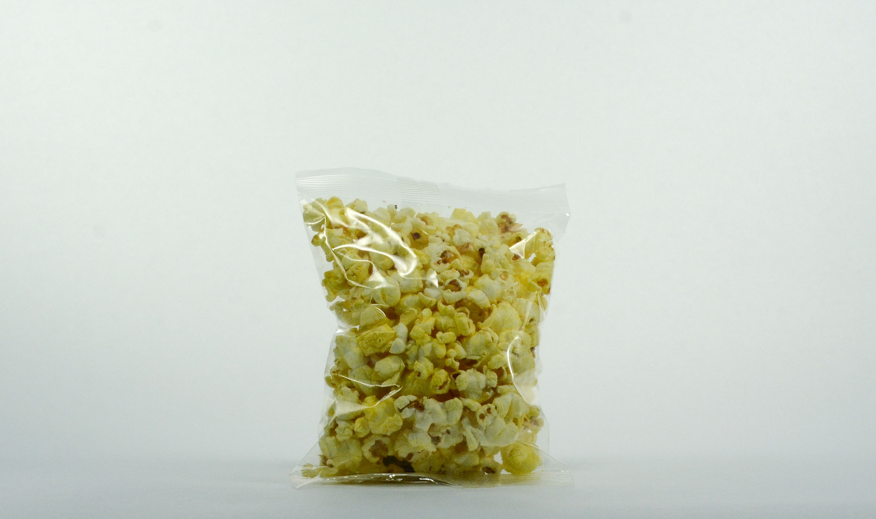 pre-packaged .75 ounce heat sealed buttery popcorn bag