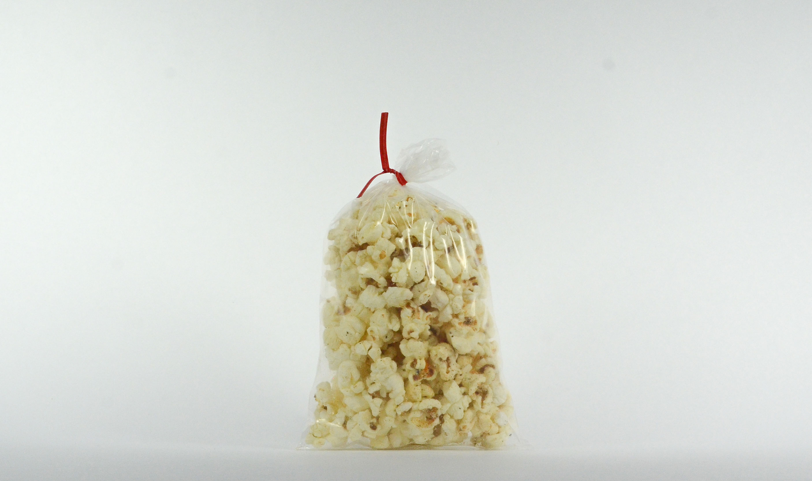 Pre-Packaged .75 ounce twist sealed white cheese corn bag